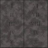 Realistiska 10 gudcommandmentsregler writed på stenminnestavlan Royaltyfria Foton