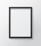 Realistyczna Czarna Pusta obrazek rama, wiesza na Białej ścianie dla Zdjęcie Stock