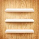 Realistyczne biel półki na drewnianej ścianie Fotografia Stock