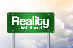Reality Green Road Sign Stock Images