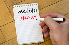 Reality show text concept on notebook. Reality show text concept write on notebook stock photo