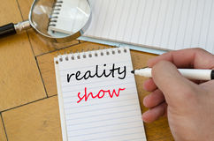 Reality show text concept on notebook. Reality show text concept write on notebook stock photography