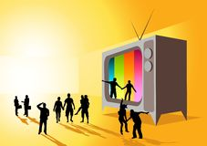 Reality Television. An old TV with people leaping out of the screen Royalty Free Stock Photo