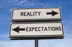 Free Reality Vs Expectation White Two Street Signs With Arrow On Metal Pole With Word Stock Photo - 173360620