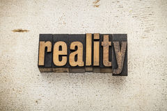 Reality word in wood type Stock Photography