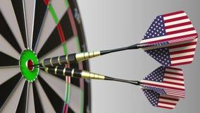 Realização nacional americana Bandeiras do Estados Unidos nos dardos que batem o bullseye Rendição 3d conceptual Fotos de Stock
