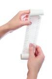 Realizar da mulher em seu recibo impresso mãos Imagens de Stock
