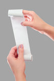 Realizar da mulher ou da menina no rolo das mãos de papel com zombaria impressa do recibo acima do molde Limpe o modelo Pode ser  Imagens de Stock Royalty Free
