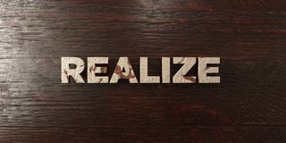 Realize - grungy wooden headline on Maple  - 3D rendered royalty free stock image Royalty Free Stock Photography