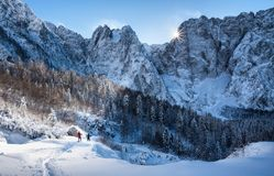 The realm of the snow. Two trekkers snowshoeing in the Julian Alps royalty free stock photos