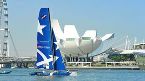 Realteam practising at Extreme Sailing Series Singapore 2013 Stock Photography