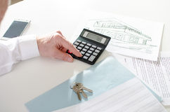 Realtor analyzing financial planning of a house Royalty Free Stock Photo