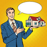 Realtor businessman offers home Royalty Free Stock Photography
