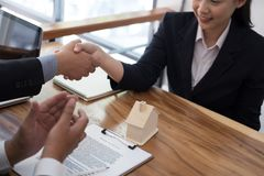 Realtor & client handshaking. real estate agent shaking hands wi. Th customer. sale & purchase property with signing contract document and approved mortgage loan Royalty Free Stock Image