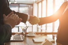 Realtor & client handshaking. real estate agent shaking hands wi. Th customer. sale & purchase property with signing contract document and approved mortgage loan Stock Image
