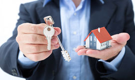 Realtor deliver with house keys Stock Image