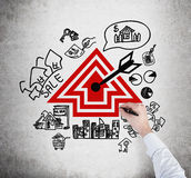 Realtor drawing real estate scheme, close up Royalty Free Stock Images