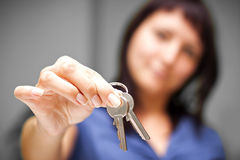 Realtor in empty apartment giving keys Royalty Free Stock Image