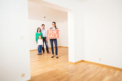 Realtor In Empty Apartment, Holding `for Sale` Sign royalty free stock photos