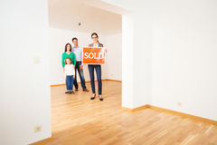 Realtor In Empty Apartment, Holding `sold` Sign Stock Images