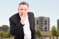 Realtor with finger on lips making silence gesture Royalty Free Stock Photography