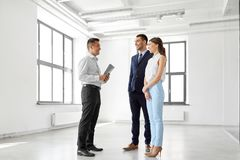 Realtor with folder and customers at new office Stock Photo