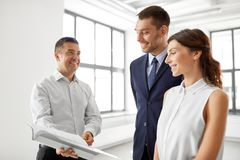 Realtor with folder showing documents to customers Royalty Free Stock Image