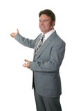 Realtor Gesturing. A realtor or businessman gesturing toward a new home or a chart.  Isolated Stock Images