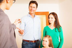 Realtor Giving Customers The Key To Their New Flat royalty free stock photos