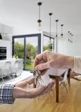 Realtor giving house key to buyer Stock Image
