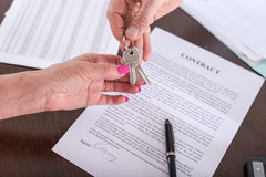 Realtor giving house keys to his client Royalty Free Stock Photos