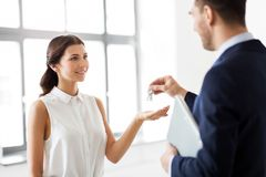 Realtor giving key to customer at new office royalty free stock images