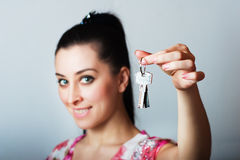Realtor is giving the keys to an apartment stock photography