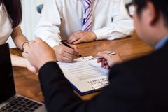 Realtor giving keys to a couple after successful deal, A couple signing contract agreement document, royalty free stock photography