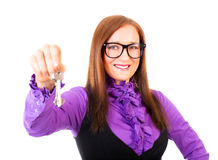 Realtor handing the keys isolated over white Stock Photography