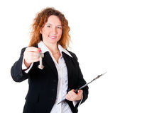 Realtor handing the keys isolated over white Royalty Free Stock Images