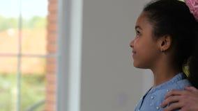 Realtor handing keys to cute little homeowner girl stock footage