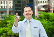 Realtor holding out the keys Royalty Free Stock Image