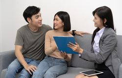 Realtor offer the house and showing detail to customers couple w royalty free stock photo