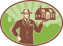 Realtor Real Estate Salesman House Retro. Illustration of a realtor real estate agent salesman holding a house for sale done in retro woodcut style set inside stock illustration