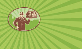 Realtor Real Estate Salesman House Retro. Business card template showing illustration of a realtor real estate agent salesman holding a house for sale done in Stock Illustration