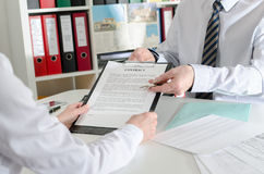 Realtor showing an estate contract and the keys to his client Stock Images