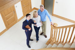 Realtor Showing Mature Couple Around House For Sale Stock Photography