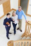 Realtor Showing Mature Couple Around House For Sale royalty free stock images