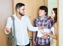 Realtor showing new apartment to couple Stock Photo