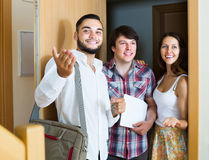 Realtor showing new apartment to couple Stock Image