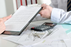 Realtor showing a real estate contract. To his client Stock Image