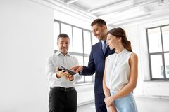 Realtor showing tablet pc to customers at office royalty free stock images