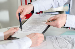 Realtor showing where to sign the real estate contract. Before delivering the keys Royalty Free Stock Photos