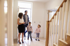 Realtor Showing Young Family Around Property For Sale royalty free stock photography